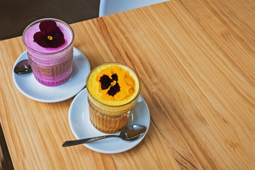Fotobehang - Two glasses of coffee latte with colorful foam