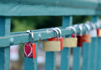 Padlocks on a metal bridge heart design