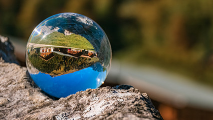Crystal ball alpine landscape shot at the famous Big Maple Ground, Tyrol, Austria