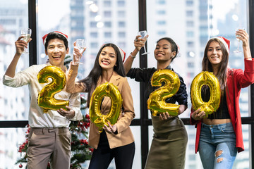 Fototapeten Alkohol Group of diversity people having great Christmas party in working office together. They celebrate with champagne and holding 2020 balloons feeling happy and enjoy laughing. Xmas, new year concept