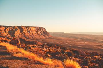 Zelfklevend Fotobehang Diepbruine sunset in the desert mountains