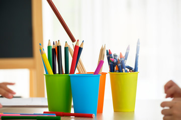 Color pencils on table in classroom for children to learn writing and drawing activity