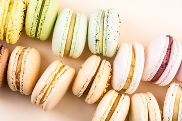 Colorful Selection of Macaroons on Pastel Background