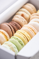 Box with Colorful Pastel Macaroons Cookies