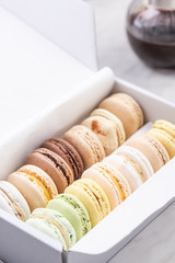 Macaroons in Box. Top Down View. Pastel Colors Palette