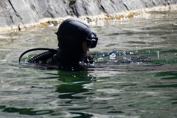 diver swims in the quarry in Ruskeala
