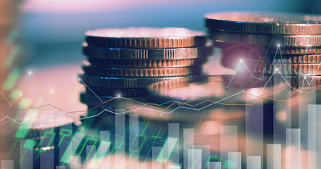 Financial investment concept, Double exposure of city night and stack of coins for finance investor, Forex trading candlestick chart, Cryptocurrency  Digital economy. background for invest