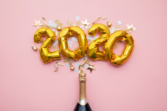 Happy new year 2020 gold celebration balloons with a champagne bottle