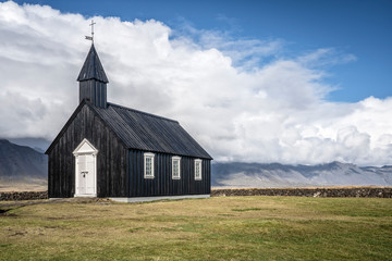 lonly black church of Budir und the south coast of Snaefellsness peninsula in western Iceland