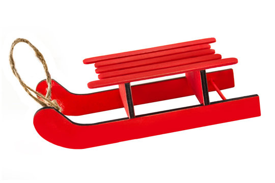 Red sledge isolated against white background