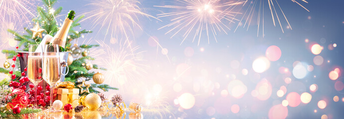 New Year Celebration With Champagne And Fireworks - Golden Lights On Blue Background