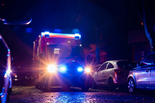 Ambulance at night, blue light, fire department, berlin, germany, out of focus photographed