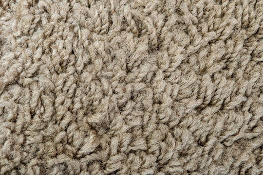 Texture of wool carpet light brown color