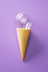 Classic light bulb in ice cream cone.