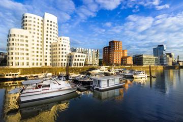 Düsseldorf, Germany - Boats in the Water and Buildings in the City Harbour Medienhafen Port in Dusseldorf Germany Fotomurales