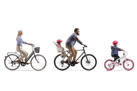 Active family of a mother, father with child in a seat and a little girl riding bicycles
