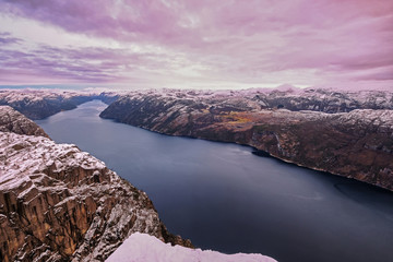 Panoramic view of Lysefjord from the Preikestolen Pulpit Rock, beautiful colors at sunset, Ryfylke, Rogaland, Norway