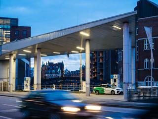 HAMBURG, GERMANY - MAR 21, 2018: CleverShuttle car sharing Driver fueling a hydrogen-powered car Toyota Mirai with GH2 hydrogen in central Hamburg, Germany dusk evening