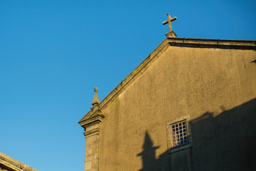 The wall of the ancient Catholic Church against the sky.