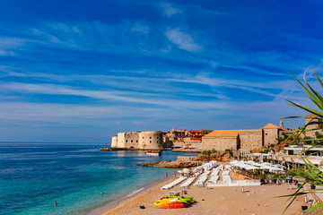 Old Harbour with Fort St Ivana and public Banje Beach in sunny day in Dubrovnik, Croatia