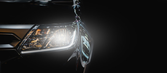Modern sport car headlight with flare on the road.