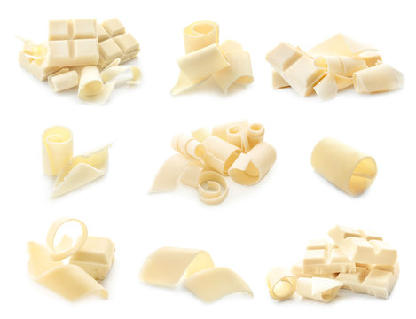 Pieces of chocolate with curls on white background