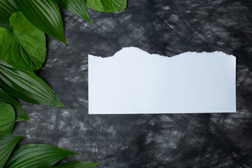 paper with flowers on a wooden background