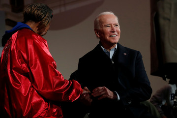 Democratic 2020 U.S. presidential candidate and former U.S. Vice President Joe Biden shakes hands during an event at the Brown Derby Ballroom in Waterloo, Iowa