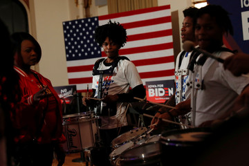 Members of the Union Baptist Crusaders drill team perform during Democratic 2020 U.S. presidential candidate and former U.S. Vice President Joe Biden's event at the Brown Derby Ballroom in Waterloo, Iowa