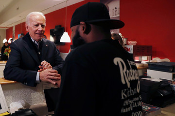 Democratic 2020 U.S. presidential candidate and former U.S. Vice President Joe Biden' shakes hands with Rodney Lewis, owner of Rodney's Kitchen, before an event at the Brown Derby Ballroom in Waterloo, Iowa