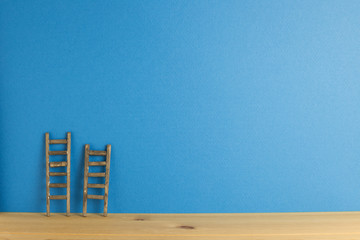 Wooden ladder with blue background. Development growth concept