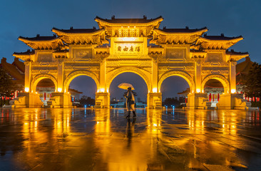 The Tourists defy the rain at Front gate of Chiang Kai Shek Memorial hall in Taipei City, Taiwan