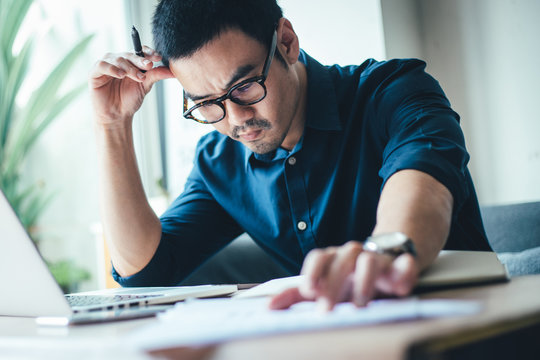 serious people frustrated exhausted work stress concept.businessman holding hands on face feeling tired suffering working on  paperwork job in work place.concept global economic problems