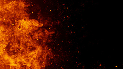Texture of burn fire with particles embers. Flames on isolated black background. Texture for banner,flyer,card .