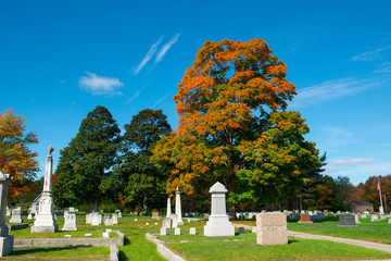 Last Rest Cemetery and trees with fall foliage in Merrimack, New Hampshire, NH, USA.