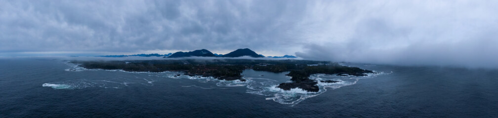 Wall Mural - Ucluelet, Vancouver Island, British Columbia, Canada. Aerial Panoramic View of a Small Town near Tofino on a Rocky Pacific Ocean Coast during a cloudy sunrise.