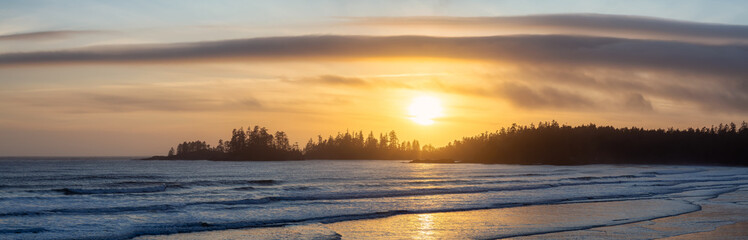 Wall Mural - Long Beach, Near Tofino and Ucluelet in Vancouver Island, BC, Canada. Beautiful panoramic view of a sandy beach on the Pacific Ocean Coast during a vibrant sunset.