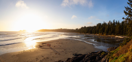 Long Beach, Near Tofino and Ucluelet in Vancouver Island, BC, Canada. Beautiful panoramic view of a sandy beach on the Pacific Ocean Coast during a vibrant sunset.