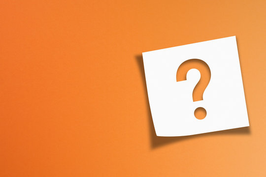 Note paper with question mark on orange background