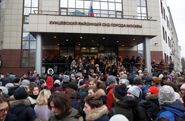 People gather before the announcement of a verdict in case of protester Zhukov in Moscow