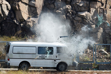 High explosives detonate inside a van at EOD depot of Hong Kong police during media tour in Hong Kong