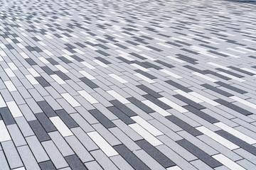 Black, white and gray elongated paving stones