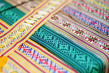Details of a traditional Lithuanian weave. Woven belts as a part of national Lithuanian costume sold on traditional Easter fair in Vilnius, Lithuania.