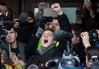 Russian protester Zhukov reacts after a court hearing in Moscow