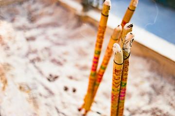 bunch of burning joss sticks or incense sticks
