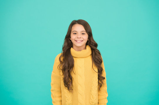 Positivity concept. Good vibes. Emotional baby. Positive child. Positive attitude to life. Inspiration. Positive mood. Kids psychology. Adorable smiling girl wear yellow sweater turquoise background