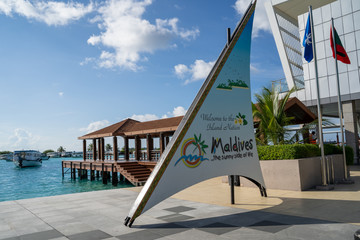 Male, Maldives - November 22, 2019: Welcome sign to the Maldives at the Velana International Airport (MLE airport code)