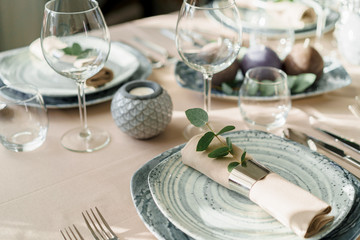 Luxury table setting for dining in pastel colors close up