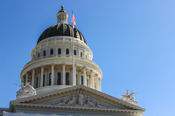 The California State Capitol is home to the government of the U.S. state of California. Close up of the top of the Capitol dome on a clear blue sky day, Sacramento.