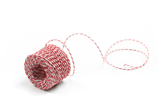 Red and white bakers twine rope spool isolated on white background. Packaging equipment or handicraft tool concept.  - Image